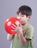 Boy and red balloon. — Stock Photo