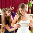 Bride at the clothes shop for wedding dresses — Stock Photo #68362163