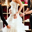 Bride at the clothes shop for wedding dresses — Stock Photo #68362189