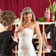 Bride at the clothes shop for wedding dresses — Stock Photo #68362259