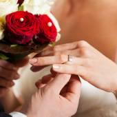 Wedding couple with  bridal ring — Stock Photo
