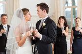 Bridal couple clinking glasses — Stock Photo