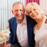Senior couple in hotel room — Stock Photo #68384897