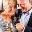 Senior couple with glass of wine — Stock Photo #68384901