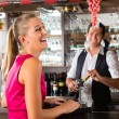 Woman ordering glass of wine at bar — Stock Photo #68384951