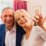 Senior couple in hotel room — Stock Photo #68385035