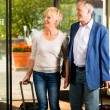Senior married couple arriving at Hotel — Stock Photo #68385051