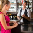 Woman ordering glass of wine at bar — Stock Photo #68385087