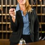 Reception - woman holding key — Stock Photo #68385097