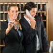 Reception in hotel - Man and woman — Stock Photo #68385111