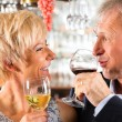 Senior couple with glass of wine — Stock Photo #68385205