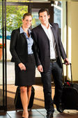 Business people arriving at Hotel — Stock Photo