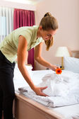 Maid doing room service in hotel — Stock Photo