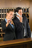 Reception in hotel - Man and woman — Stock Photo