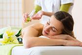Woman having back massage — Stock Photo