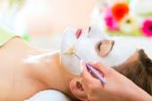 Woman getting face mask — Stock Photo