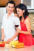Asian couple preparing food — Stock Photo