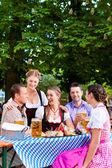 Friends on a table with beer — Stock Photo