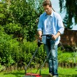 Man is mowing the lawn in summer — Stock Photo #69306251