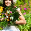 Gardening in summer - woman with flowers — Stock Photo #69306313