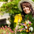 Gardening in summer - woman with flowers — Stock Photo #69306329