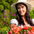Gardening in summer - woman with flowers — Stock Photo #69306405