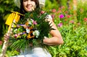 Gardening in summer - woman with flowers — Stock Photo