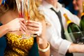 Couple with Champagner in club or party — Stock Photo