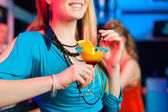 People in club or bar drinking cocktails — ストック写真