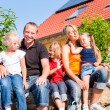 Family in front of home or house — Stock Photo #69591675