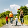 Family walking down that summer path — Stock Photo #69591707
