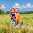 Mother and Daughter in summer on meadow — Stock Photo #69591719