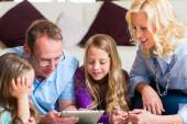 Family playing with Tablet computer at home — Stock Photo