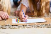 Children coloring on floor — 图库照片