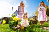 Children on Easter egg hunt with bunny — Stock Photo