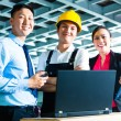 Worker, Production manager and owner in factory — Stock Photo #69698311