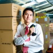 Young Man in a warehouse with Scanner — Stock Photo #69698419
