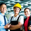 Worker, Production manager and owner in factory — Stock Photo #69698435