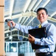 Indonesian Man in warehouse with Scanner — Stock Photo #69698437