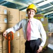 Young Man in warehouse he is a manager — Stock Photo #69698561