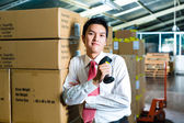 Young Man in a warehouse with Scanner — Stock Photo