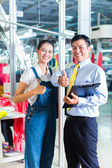 Asian foreman in textile factory — Stock Photo