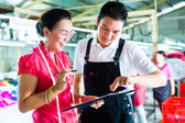 Production manager and designer in a factory — Stock Photo
