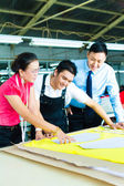 Worker, Dressmaker and CEO in a factory — Stock Photo