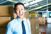 Customer Service in a warehouse — Stock Photo