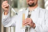 Beer brewer in his brewery examining — Stock Photo