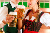 Man and woman with beer glass in brewery — Stock Photo