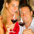 Man and woman tasking wine in cellar — Stock Photo #71510961