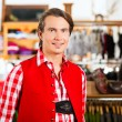 Man is trying Tracht or Lederhosen in a shop — Stock Photo #71689543