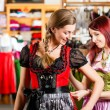 Woman is trying Tracht or dirndl in a shop — Stock Photo #71689581